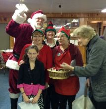 Santa and Lubec Women's Club Elves